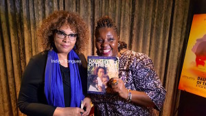 Julie Dash and Director of Indigo Tongues Mojisola Sonoiki showing off her book of Daughters of the Dust.
